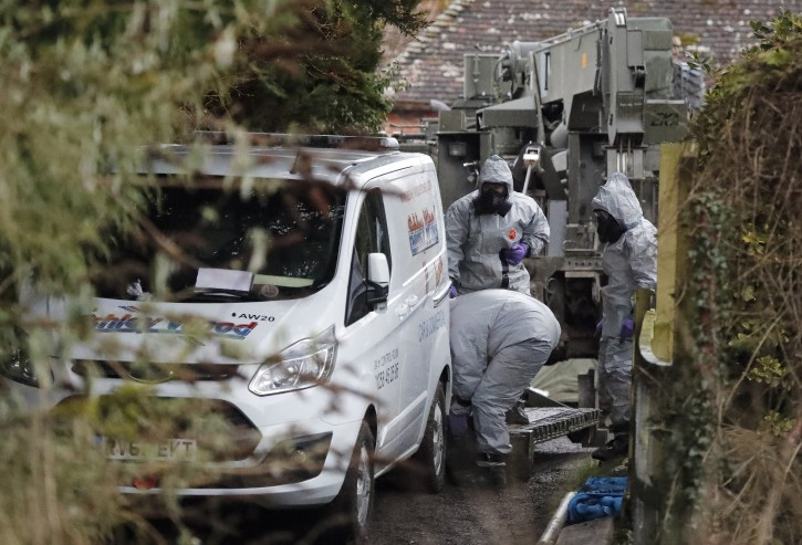 Military forces work on a van in Winterslow, England, Monday, March 12, 2018, as investigations continue into the nerve-agent poisoning of Russian ex-spy Sergei Skripal and his daughter Yulia, in Salisbury, England, on Sunday March 4,2018. British Prime Minister Theresa May is set to update lawmakers Monday on the nerve-agent poisoning of ex-spy Sergei Skripal and his daughter. (AP Photo/Frank Augstein)