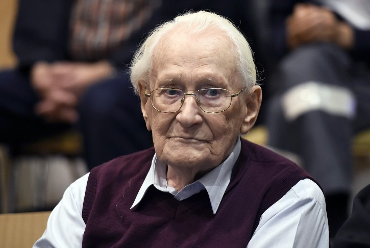 "FILE - In this July 15, 2015 file photo defendant Oskar Groening waits for the verdict of his trial at a court in Lueneburg, northern Germany. Groening, a former SS officer known as the ""Bookkeeper of Auschwitz"" was sentenced to four years prison. (Tobias Schwarz/pool photo via AP, file)"