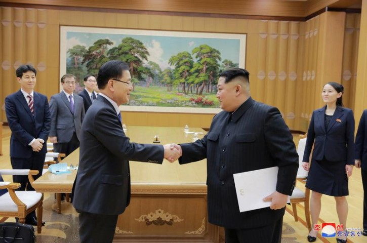 North Korean leader Kim Jong Un shakes hands with a member of the special delegation of South Korea's President in this photo released by North Korea's Korean Central News Agency (KCNA) on March 6, 2018. KCNA/via Reuters