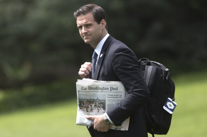 Aide to US President Donald J. Trump, John McEntee, holds a copy of the Washington Post newspaper as he walks across the South Lawn to depart the White House by Marine One, in Washington, DC, USA, 07 June 2017. EPA