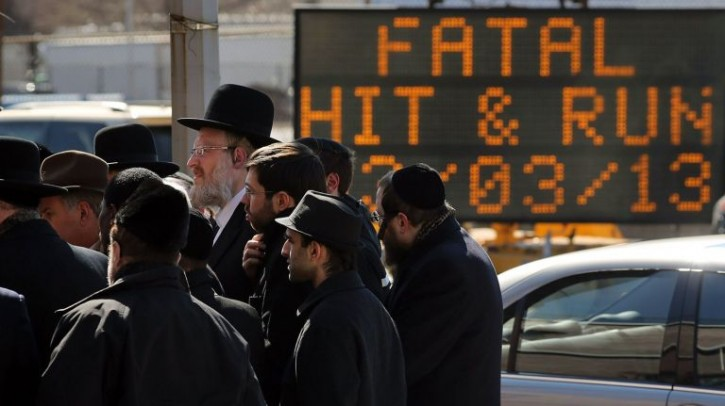 FILE - A hit-and-run alert system has taken effect this week. Members of the Orthodox Jewish community attend a news conference on the deaths of a couple and their unborn child in a hit-and-run crash in Brooklyn on March 4, 2013. Photo Credit: Getty Images / Spencer Platt