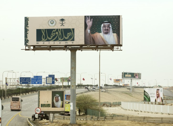 "Billboards with photos of Saudi King Salman and Arabic that reads, ""welcome"" line the road to the convention center where Arab leaders are meeting for an Arab  summit meeting in Dhahran, Saudi Arabia, Sunday, April 15, 2018. The summit opened in the eastern Saudi city of Dhahran as tensions with Iran and wars in Syria and Yemen threaten stability across the region. Salman told leaders from across the 22-member Arab League that Iran was to blame for instability and meddling in the region. (AP Photo/Amr Nabil)"