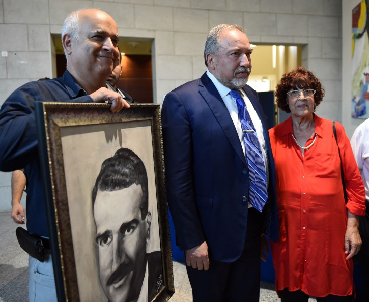FILE - Defense Minister Avigdor Liberman attends the memorial ceremony forthe late former Mossad agent Eli Cohen, with his widow, Nadia Cohen, on June 20, 2017.