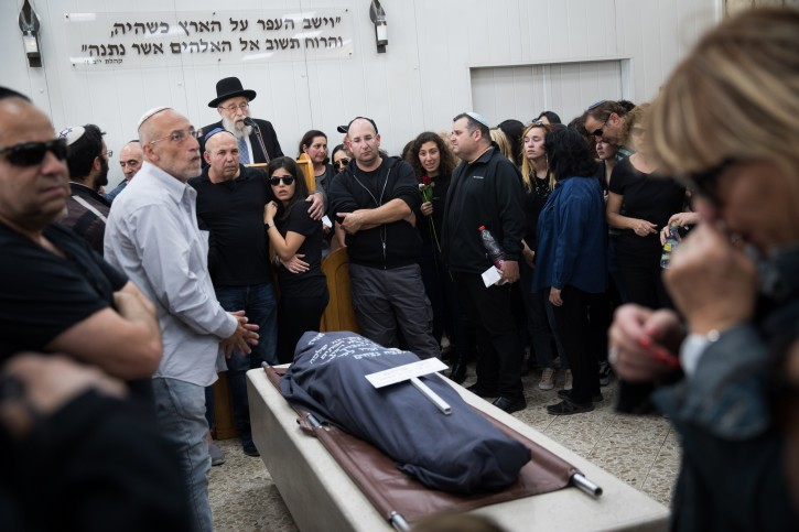 Family and friends mourn during the funeral of 18-year-old Maayan Barhom at the Har Hamenuchot cemetery in Jerusalem, Friday, April 27, 2018.