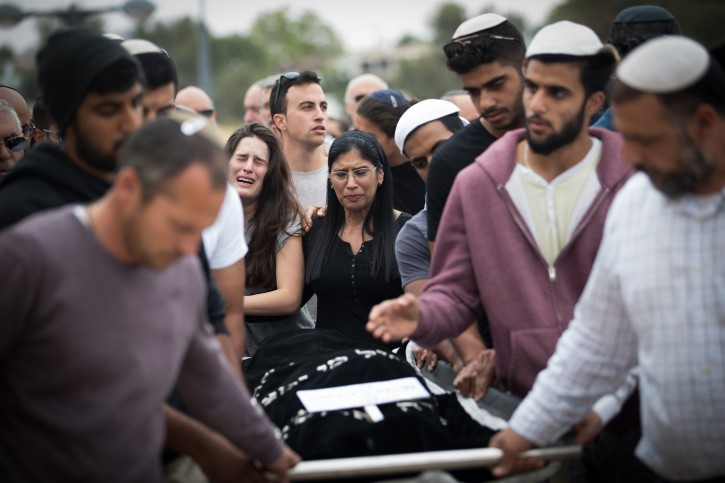Friends and family carry the body of Ella Or during her funeral in Mishor Adummim on April 27, 2018.