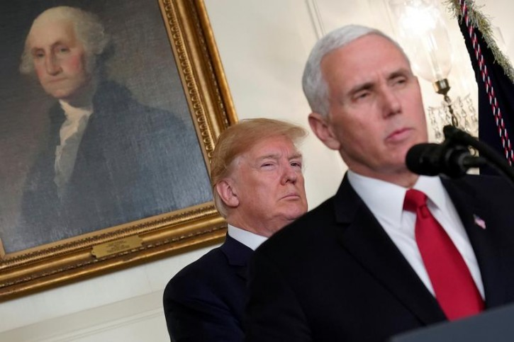 FILE - U.S. President Donald Trump listens to remarks by Vice President Mike Pence before signing a memorandum on intellectual property tariffs on high-tech goods from China, at the White House in Washington, U.S. March 22, 2018.  REUTERS/Jonathan Ernst
