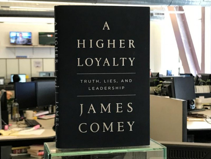 """A copy of former FBI director James Comey's book """"A Higher Loyalty"""" is seen in New York City, New York, U.S. April 13, 2018.  REUTERS/Soren Larson"""