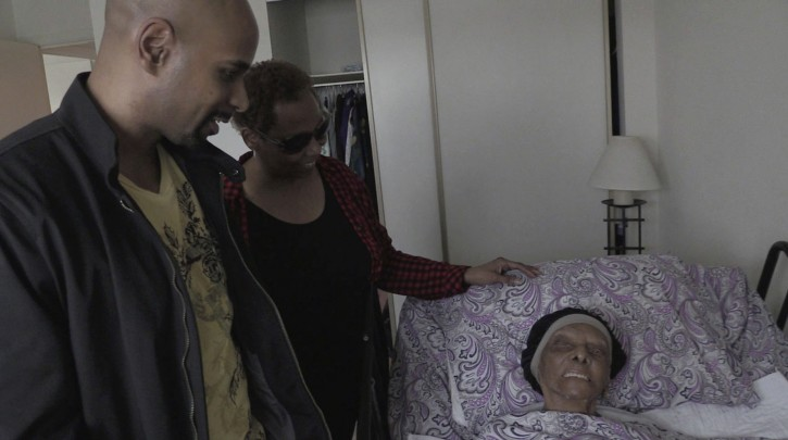 In this May 11, 2018 frame from video, family members stop by to visit with Lessie Brown, who is 113, in Cleveland Heights, Ohio. She is believed to be the oldest person in the United States after the death of a 114-year-old Pennsylvania woman. (David Petkiewicz/The Plain Dealer via AP)