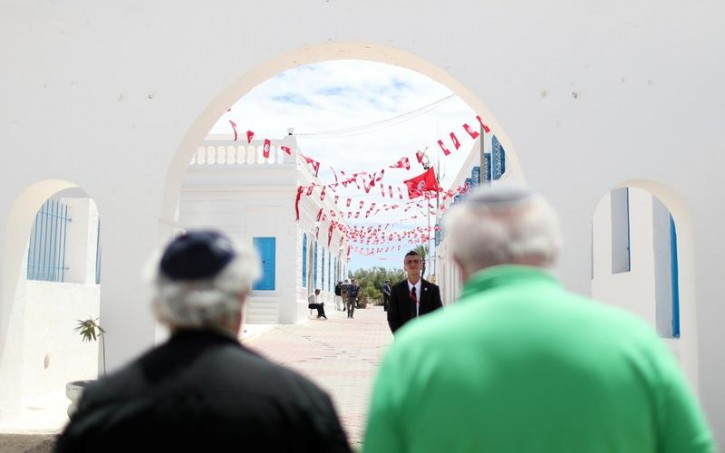 Two Jewish men arrive to Ghriba, the oldest Jewish synagogue in Africa, during an annual pilgrimage in Djerba, Tunisia May 3, 2018. Picture taken May 3, 2018. REUTERS/Ahmed Jadallah