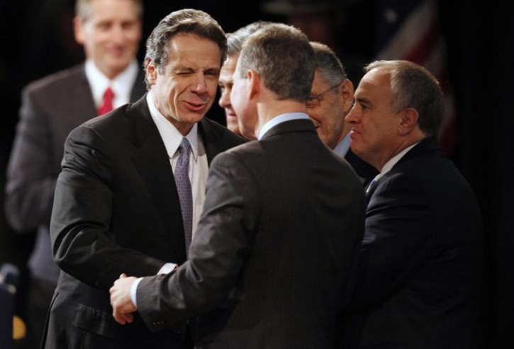FILE - New York Governor Andrew Cuomo (L) winks as he greets State Attorney General Eric T. Schneiderman while State Comptroller Thomas DiNapoli looks on (R) at the Empire State Plaza Convention center in the New York State Capitol complex in Albany, New York, January 5, 2011. Reuters