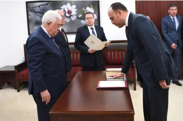 FILE - Husam Zomlot is sworn-in in front of President Mahmoud Abbas as head of the PLO General Delegation to the United States on March 7 (Usama Falah-WAFA)