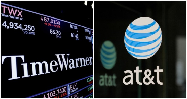 FILE - A combination photo shows the Time Warner shares price at the New York Stock Exchange and AT&T logo in New York, NY, U.S., on November 15, 2017 and on October 23, 2016 respectively.  REUTERS/Lucas Jackson (L) and REUTERS/Stephanie Keith/File Photos