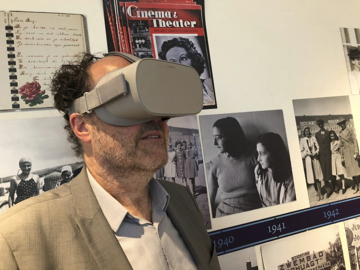 Ronald Leopold, executive director of the Anne Frank House, views a new virtual reality presentation of the secret rooms where teenage Jewish diarist Anne Frank hid from the Nazis during World War II, in Amsterdam on Tuesday, June 12, 2018. To mark what would have been Anne Frank's 89th birthday, the museum dedicated to her life has launched the virtual reality tour of the cramped quarters where the Jewish diarist and her family hid from Nazis during World War II. (Aleksandar Furtula/AP Photo)