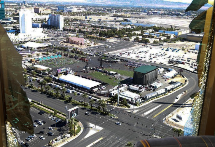 FILE - This October 2017 file photo released by the Las Vegas Metropolitan Police Department Force Investigation Team Report shows the view of Las Vegas Village from Mandalay Bay's room 32-135, part of the evidence images.  (Las Vegas Metropolitan Police Department via AP, File)