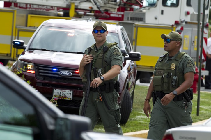 Maryland police officers patrol the area after multiple people were shot at at The Capital Gazette newspaper in Annapolis, Md., Thursday, June 28, 2018. (AP Photo/Jose Luis Magana)