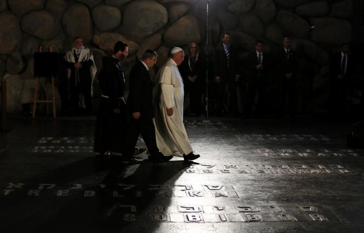 FILE - Pope Francis (C) walks past the names of former Nazi concentration camps during a ceremony in the Hall of Remembrance at the Yad Vashem Holocaust memorial in Jerusalem May 26, 2014. Reuters