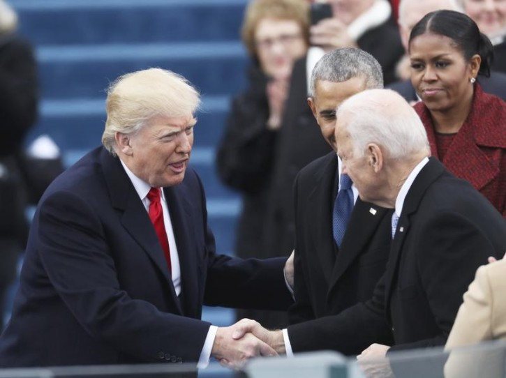 FILE - Vice President Joe Biden (R) shakes hands with President elect Donald Trump at inauguration ceremonies swearing in Donald Trump as the 45th president of the United States on the West front of the U.S. Capitol in Washington, U.S., January 20, 2017. REUTERS/Carlos Barria