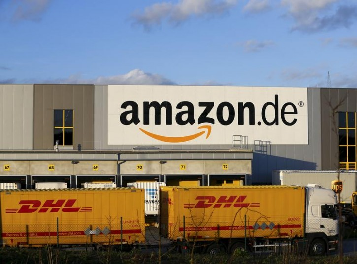 FILE - A truck of German postal and logistics group Deutsche Post DHL leaves the Amazon logistics center in Koblenz, western Germany December 23, 2015.   REUTERS/Wolfgang Rattay