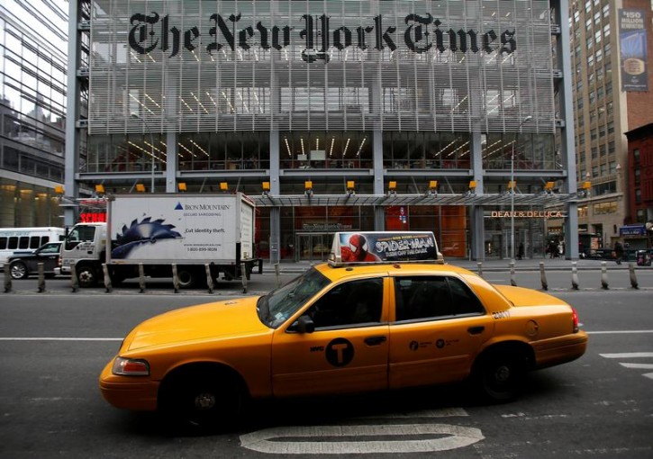 FILE - A taxi passes by in front of The New York Times head office in New York, February 7, 2013.  REUTERS/Carlo Allegri/File Photo