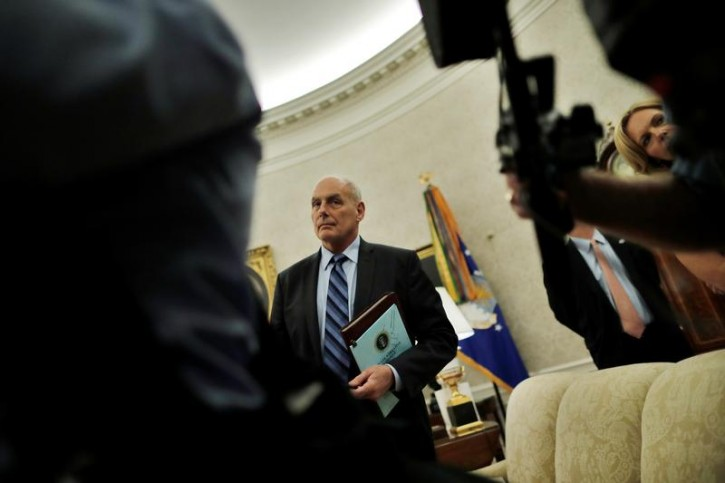 FILE   White House Chief Of Staff John Kelly Listens As U.S. President  Donald Trump Participates