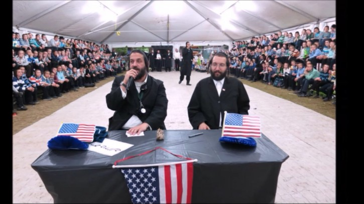 Reuven Chaim Biller (left) is seen in camp in this 2016 photo