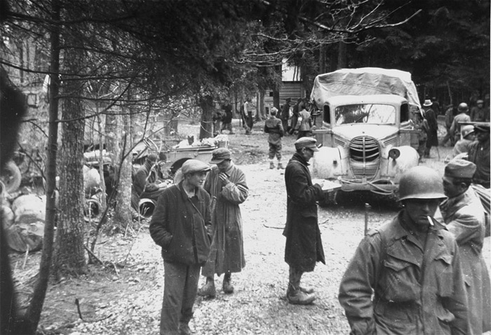 Survivors and American troops in Gunskirchen, a subcamp of the Mauthausen concentration camp, after the war.