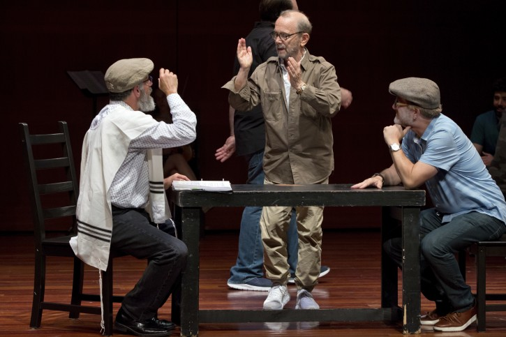 "In this Tuesday, June 19, 2018, photo, director Joel Grey, center, works with the National Yiddish Theatre Folksbiene cast of a Yiddish-language version of ""Fiddler on the Roof,"" at the at the Museum of Jewish Heritage, in New York. (AP Photo/Richard Drew)"