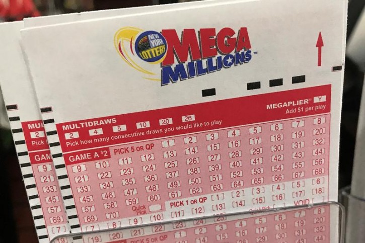 A Mega Millions ticket is pictured in a store in New York City, New York, U.S., January 5, 2018. REUTERS/Carlo Allegri