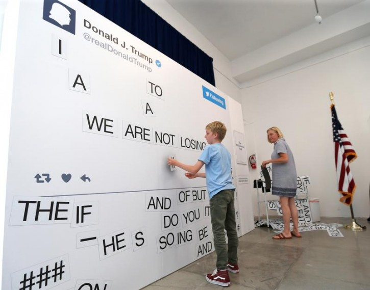 Visitors compose tweets at The Donald J. Trump Presidential Twitter Library presented by The Daily Show in West Hollywood, California, U.S., June 8, 2018. REUTERS/Mario Anzuoni
