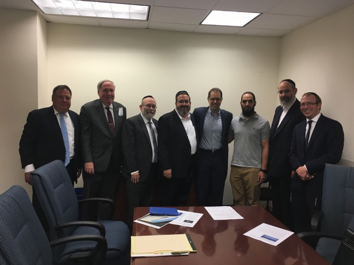 (L-R James Blair Blair funeral director Hebrew Free Burial, John Goldin President of the Metropolitan   Funeral Directors Assoc., Rabbi Elchonon Zohn National Association of chevra Kadisha, Meyer Weill VP Misaskim, Councilman Mark Levine, Noor Rahba CEO Muslim funeral services, Jack Meyer Pres Misaskim, Andrew Parver Undertaker Hebrew free burial society