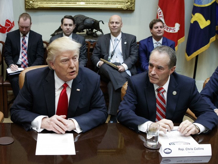 FILE - In this Feb. 16, 2017 file photo Republican U.S. Rep. Chris Collins, right, of New York, sits next to President Donald Trump during a meeting with House Republicans in the Roosevelt Room of the White House in Washington.   (AP Photo/Evan Vucci, File)