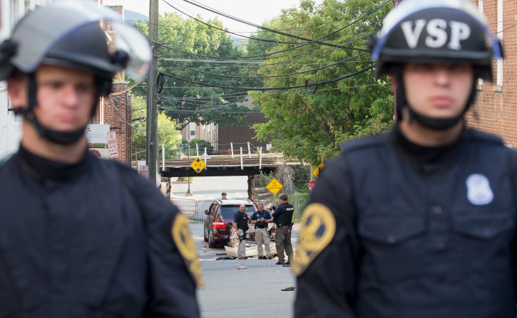 FILE - Virginia State Police inspect the site where a vehicle hit protesters in Charlottesville, Virginia, USA, 12 August 2017.EPA