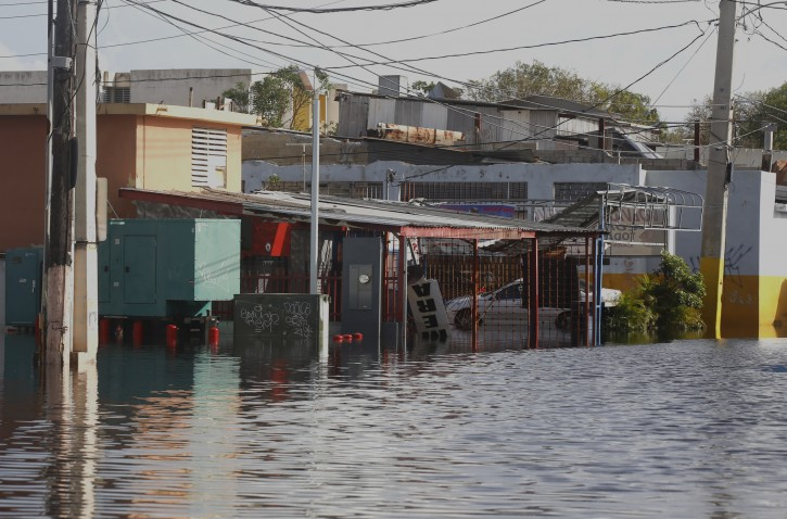 FILE - General view of a flooded street in the aftermath of Hurricane Maria, in San Juan, Puerto Rico, 23 September 2017. EPA