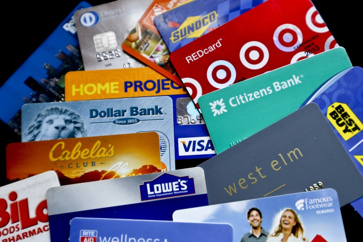 In this Jan. 31, 2018, photo, an assortment of credit cards and rewards cards are shown in Zelienople, Pa. (AP Photo/Keith Srakocic)