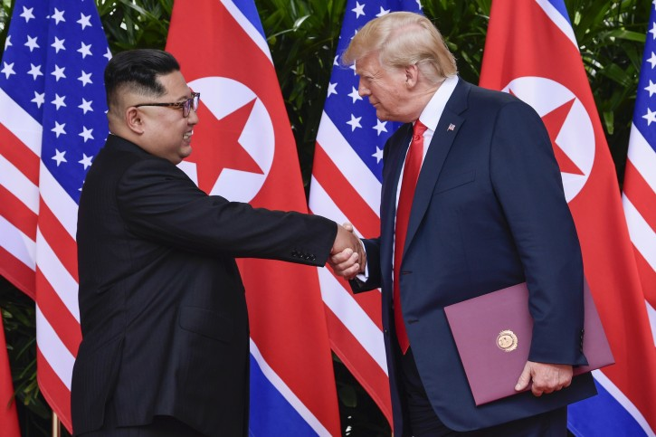 FILE - In this June 12, 2018, file photo, North Korea leader Kim Jong Un, left, and U.S. President Donald Trump shake hands at the conclusion of their meetings at the Capella resort on Sentosa Island in Singapore. (AP Photo/Susan Walsh, Pool, File)