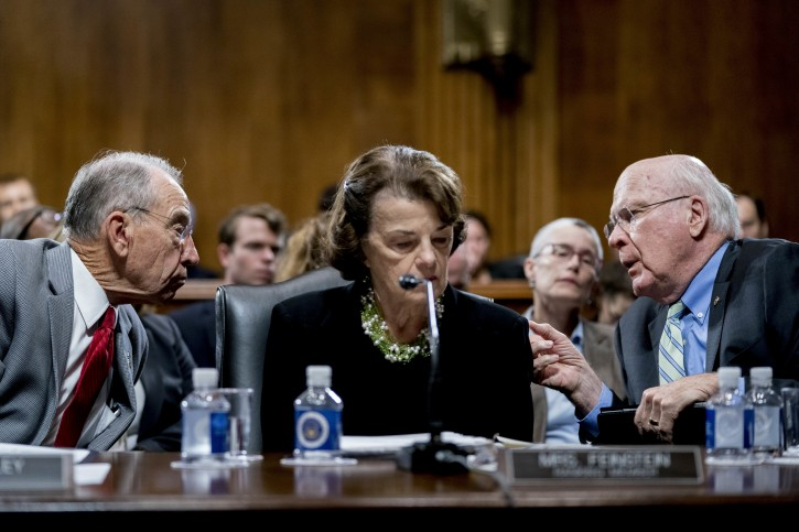Senate Judiciary Committee Chairman Chuck Grassley, R-Iowa, left, accompanied by Sen. Dianne Feinstein, D-Calif., the ranking member, center, speaks with Sen. Patrick Leahy, D-Vt., right, during a Senate Judiciary Committee markup meeting on Capitol Hill, Thursday, Sept. 13, 2018, in Washington.(AP Photo/Andrew Harnik)