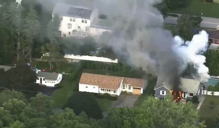 In this image take from video provided by WCVB in Boston, flames rise from a house in Lawrence, Mass, a suburb of Boston, Thursday, Sept. 13, 2018. Emergency crews are responding to what they believe is a series of gas explosions that have damaged homes across three communities north of Boston. (WCVB via AP)