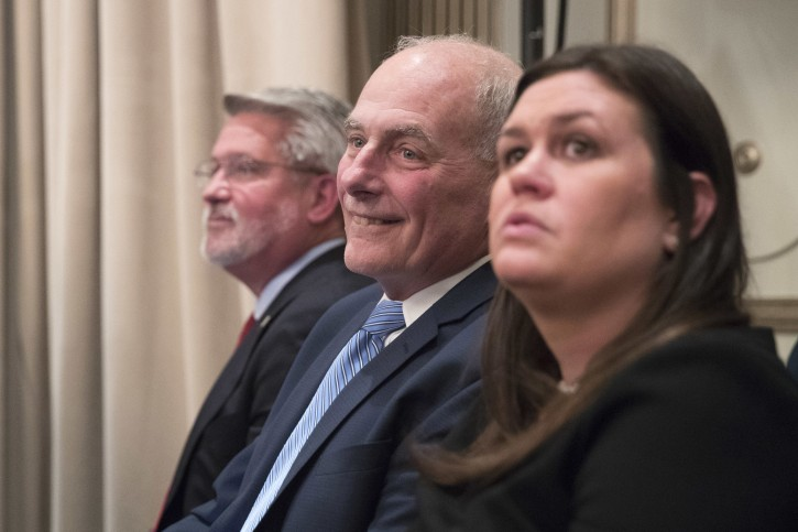Communications Chief Bill Shine, left, Chief of Staff John Kelly, center, White House Press Secretary Sarah Huckabee Sanders listen as  President Donald Trump speaks during a news conference, Wednesday, Sept. 26, 2018, in New York. (AP Photo/Mary Altaffer)