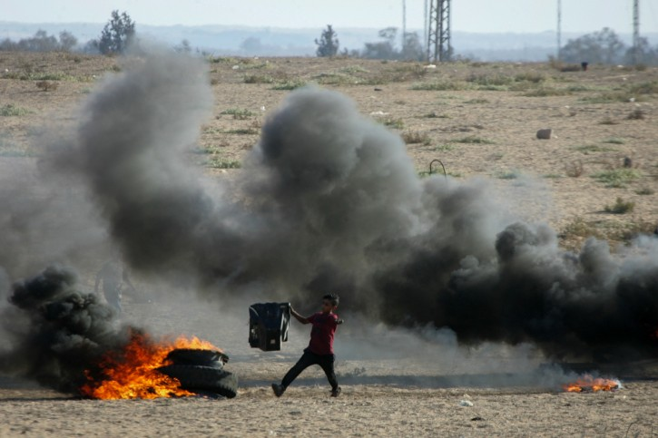 Palestinian protesters clash with Israeli troops near the Gaza-Israel border, east of the southern Gaza Strip city of Rafah, on Sept. 21, 2018.  EPA