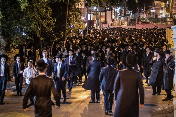 Ultra Orthodox Jewish men gather to protest against the lightrail construction work taking place on Shabbat, in the Ultra Orthodox city of Bnei Brak, on September 21, 2018. Photo by Roy Alima/Flash90