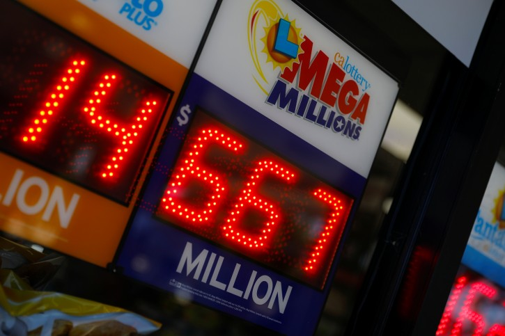 A sign at a gas station shows the current record breaking  $667 million U.S. Mega Millions jackpot in Encinitas, California, U.S. October 16, 2018.  REUTERS/Mike Blake