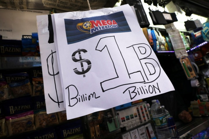 Signs display the jackpots for Mega Millions lottery drawing at a newsstands in midtown Manhattan in New York, U.S., October 19, 2018.   REUTERS/Mike Sugar