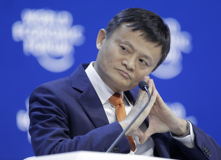 FILE - In this Wednesday, Jan. 24, 2018 file photo, Alibaba founder Jack Ma listens during a session of the annual meeting of the World Economic Forum in Davos, Switzerland. Jack Ma defended trade at a World Trade Organization seminar Tuesday, Oct. 2, 2018 in Switzerland. (AP Photo/Markus Schreiber)