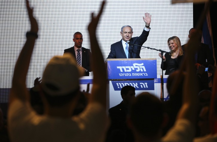 FILE - In this March 17, 2015 file photo, Israeli Prime Minister Benjamin Netanyahu greets supporters at the party's election headquarters in Tel Aviv, Israel.  (AP Photo/Oded Balilty, File)