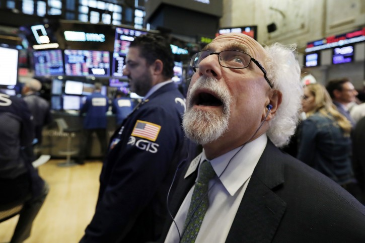 Trader {eter Tuchman works on the floor of the New York Stock Exchange, Wednesday, Oct. 10, 2018. AP