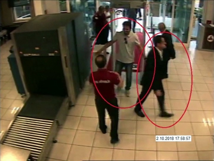 In a still image from surveillance camera footage taken Oct. 2, 2018, and published Thursday, Oct. 18, 2018, by the pro-government Turkish newspaper Sabah, a man, right, previously seen with Saudi Crown Prince Mohammed bin Salman's entourage during an April trip to the U.S. walks at Ataturk Airport in Istanbul just before writer Jamal Khashoggi disappeared there. ( Sabah via AP )