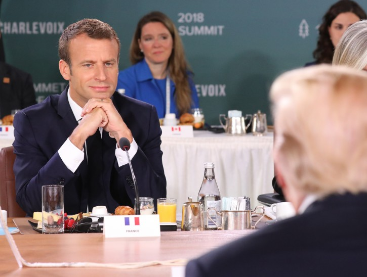 FILE - French President Emmanuel Macron (L) looks at US President Donald J. Trump (R) as they attend the G7 and Gender Equality Advisory Council Breakfast at the G7 summit in Charlevoix in Canada 09 June 2018. The G7 Summit runs from 08 to 09 June in Charlevoix, Canada.  EPA-EFE/LUDOVIC MARIN