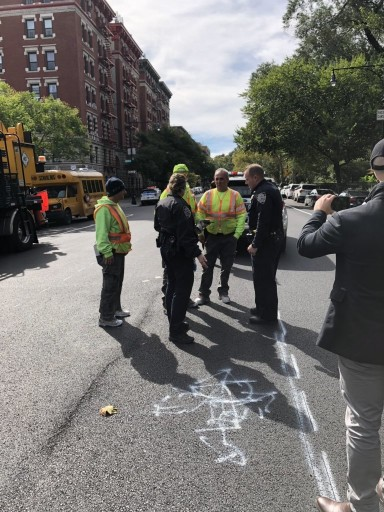DOT Officials stand next to the graffiti new markings that had been added to the swastika, rendering it unrecognizable.