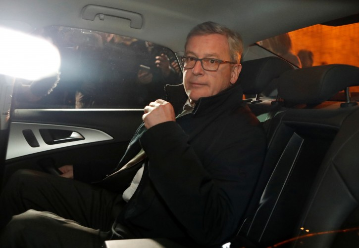 Austrian Ambassador to Russia Johannes Eigner sits inside a car as he leaves the Russian Foreign Ministry headquarters after it was declared that Austria suspects a recently retired military officer in spying for Russia for decades, in Moscow, Russia November 9, 2018. REUTERS/Sergei Karpukhin