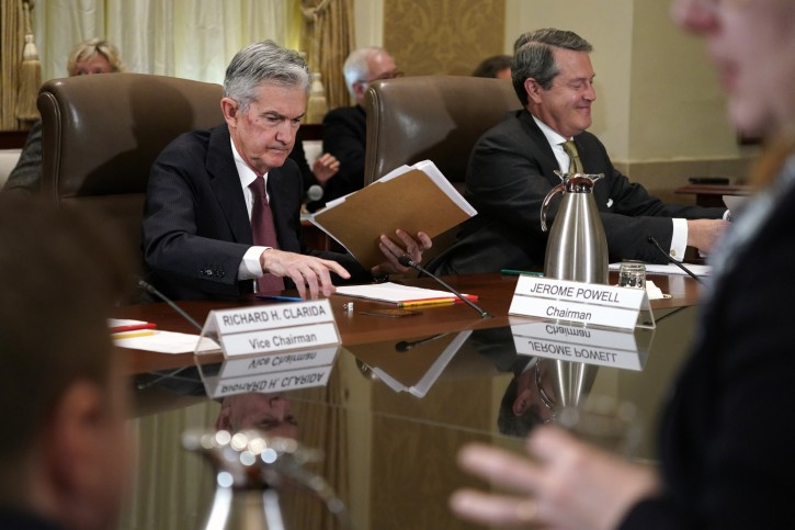 Federal Reserve Chair Jerome Powell, left, and Randal Quarles, vice chair for supervision, gather their things at the end of a Federal Reserve Board meeting to discuss proposed rules to modify the enhanced prudential standard framework for large banking organizations, Wednesday, Oct. 31, 2018, at the Marriner S. Eccles Federal Reserve Board Building in Washington. (AP Photo/Jacquelyn Martin)